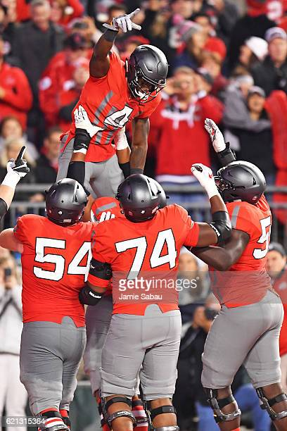 Curtis Samuel of the Ohio State Buckeyes celebrates in the end zone with Billy Price Jamarco Jones and Isaiah Prince all of the Ohio State Buckeyes...