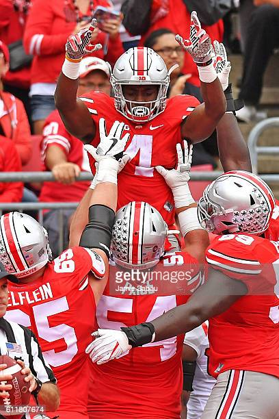 Curtis Samuel of the Ohio State Buckeyes celebrates with his linemen in the end zone after scoring on a fiveyard touchdown reception in the second...