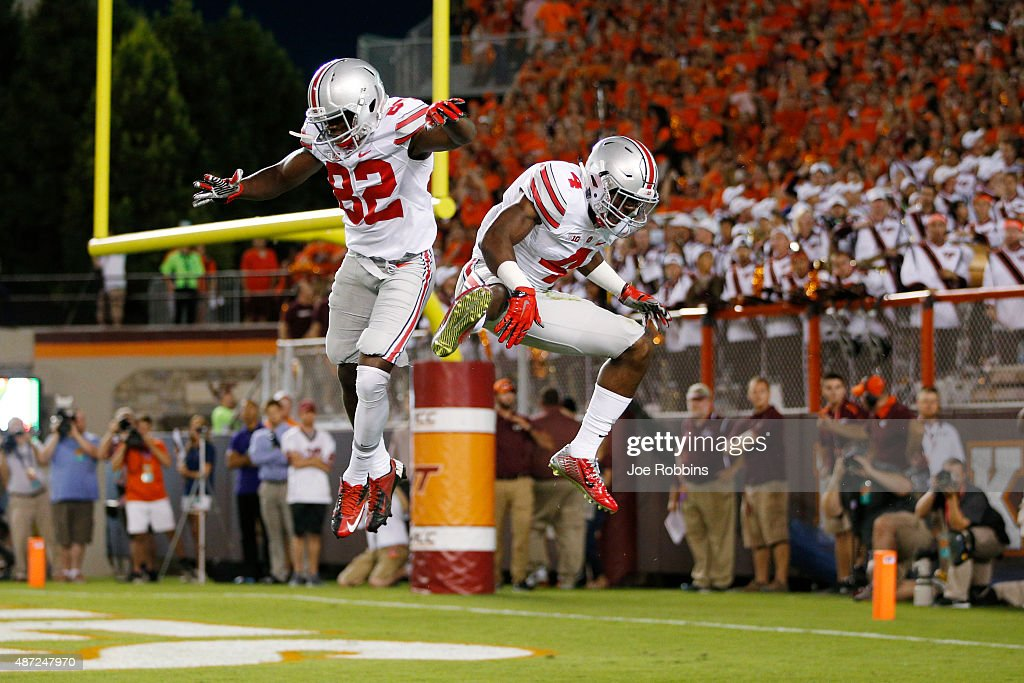 Curtis Samuel of the Ohio State Buckeyes celebrates with James Clark after a 24yard touchdown reception in the first quarter against the Virginia...