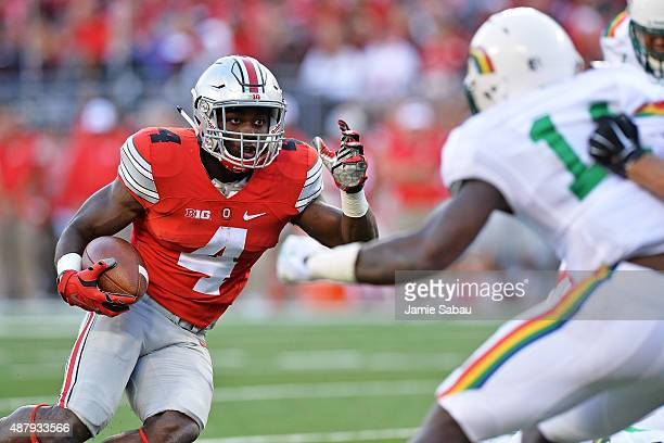 Curtis Samuel of the Ohio State Buckeyes looks for running room as he nears the goal line in the fourth quarter against the Hawaii Rainbow Warriors...