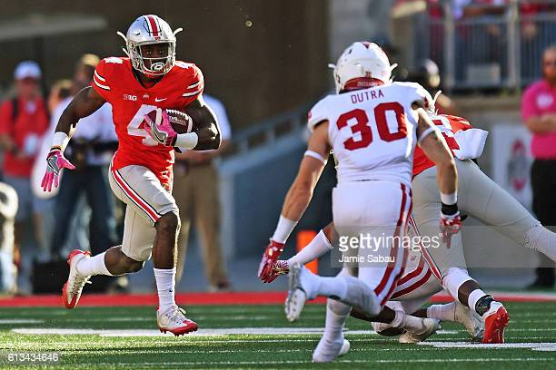 Curtis Samuel of the Ohio State Buckeyes looks for running room as Chase Dutra of the Indiana Hoosiers closes in for the tackle in the second quarter...