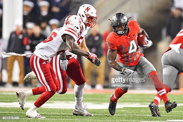 Curtis Samuel of the Ohio State Buckeyes looks for running room around Thomas Connely of the Nebraska Cornhuskers and Josh Banderas of the Nebraska...