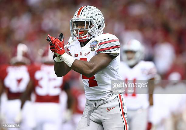 Curtis Samuel of the Ohio State Buckeyes pumps up the crowd in the first half against Alabama during the All State Sugar Bowl at the MercedesBenz...