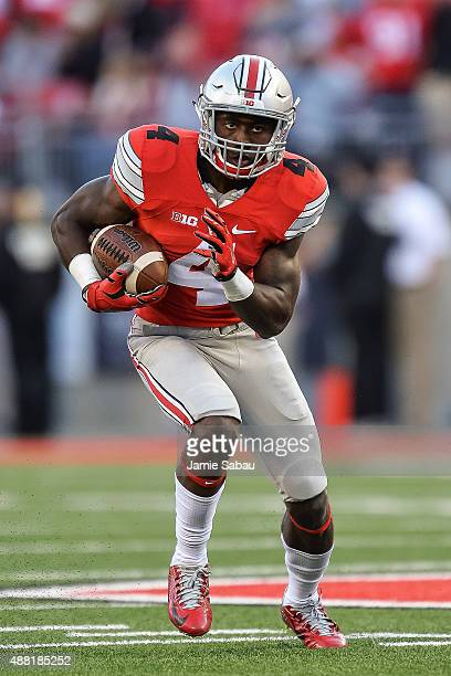 Curtis Samuel of the Ohio State Buckeyes runs against the Hawaii Rainbow Warriors at Ohio Stadium on September 12 2015 in Columbus Ohio