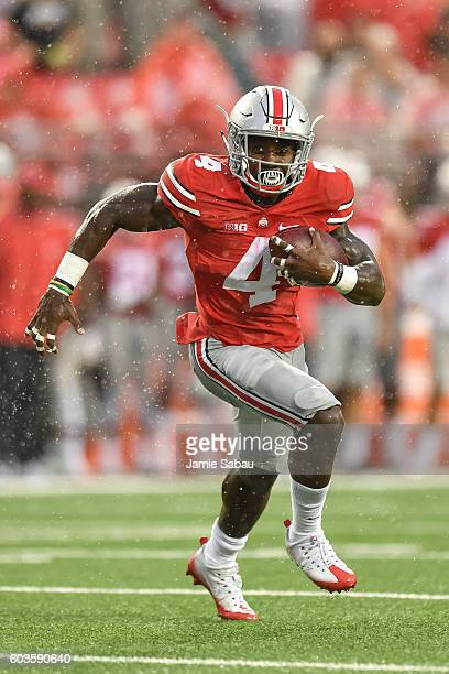 Curtis Samuel of the Ohio State Buckeyes runs with the ball against the Tulsa Hurricane at Ohio Stadium on September 10 2016 in Columbus Ohio Ohio...