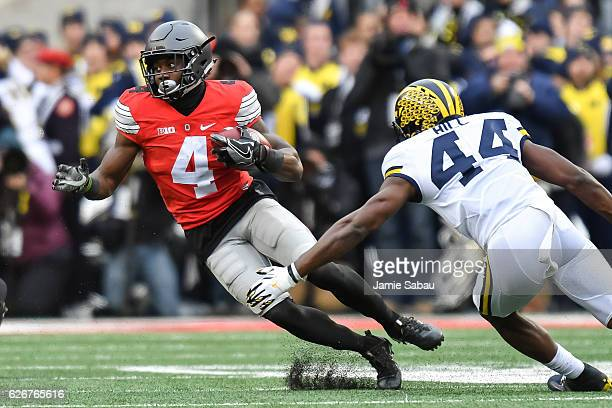 Curtis Samuel of the Ohio State Buckeyes runs with the ball against the Michigan Wolverines at Ohio Stadium on November 26 2016 in Columbus Ohio Ohio...