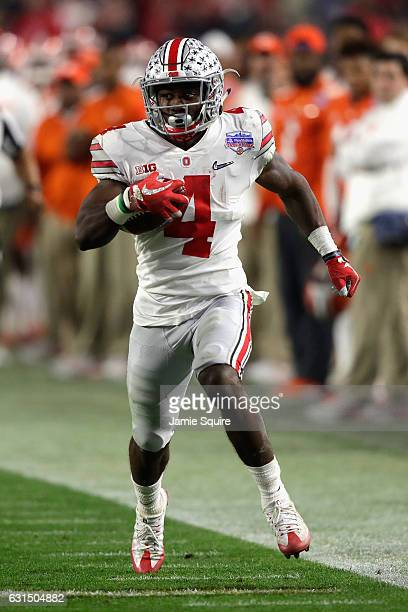 Curtis Samuel of the Ohio State Buckeyes runs with the ball against the Clemson Tigers during the 2016 PlayStation Fiesta Bowl at University of...