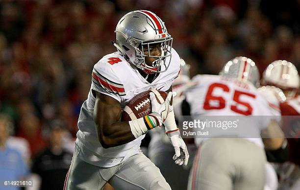 Curtis Samuel of the Ohio State Buckeyes runs with the ball in the first quarter against the Wisconsin Badgers at Camp Randall Stadium on October 15...