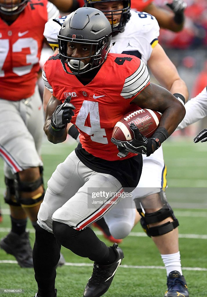 Curtis Samuel #4 of the Ohio State Buckeyes rushes for the game-winning touchdown in overtime against the Michigan Wolverines at Ohio Stadium on November 26, 2016 in Columbus, Ohio.