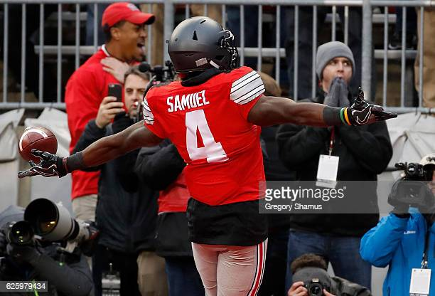 Curtis Samuel of the Ohio State Buckeyes scores the winning touchdown in double overtime against the Michigan Wolverines at Ohio Stadium on November...