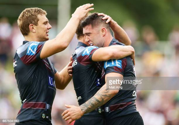 Curtis Sironen of the Sea Eagles celebrates with team mates after scoring a try during the round four NRL match between the Manly Warringah Sea...