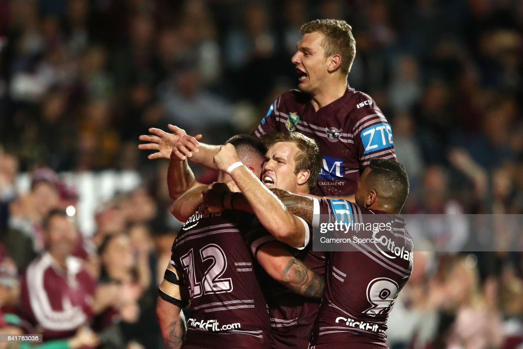 Curtis Sironen of the Sea Eagles is congratulated by Jake Trbojevic of the Sea Eagles and team mates after scoring a try during the round 26 NRL match between the Manly Sea Eagles and the Penrith Panthers at Lottoland on September 2, 2017 in Sydney, Australia.