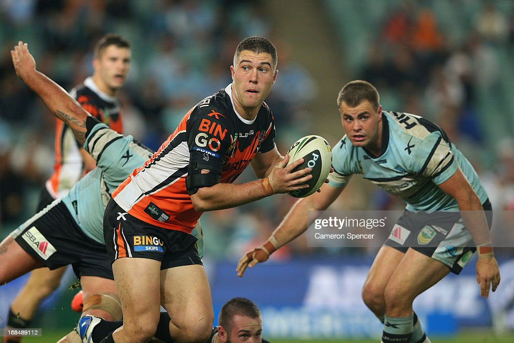 Curtis Sironen of the Tigers looks to pass during the round nine NRL match between the Wests Tigers and the Cronulla Sharks at Allianz Stadium on May 10, 2013 in Sydney, Australia.