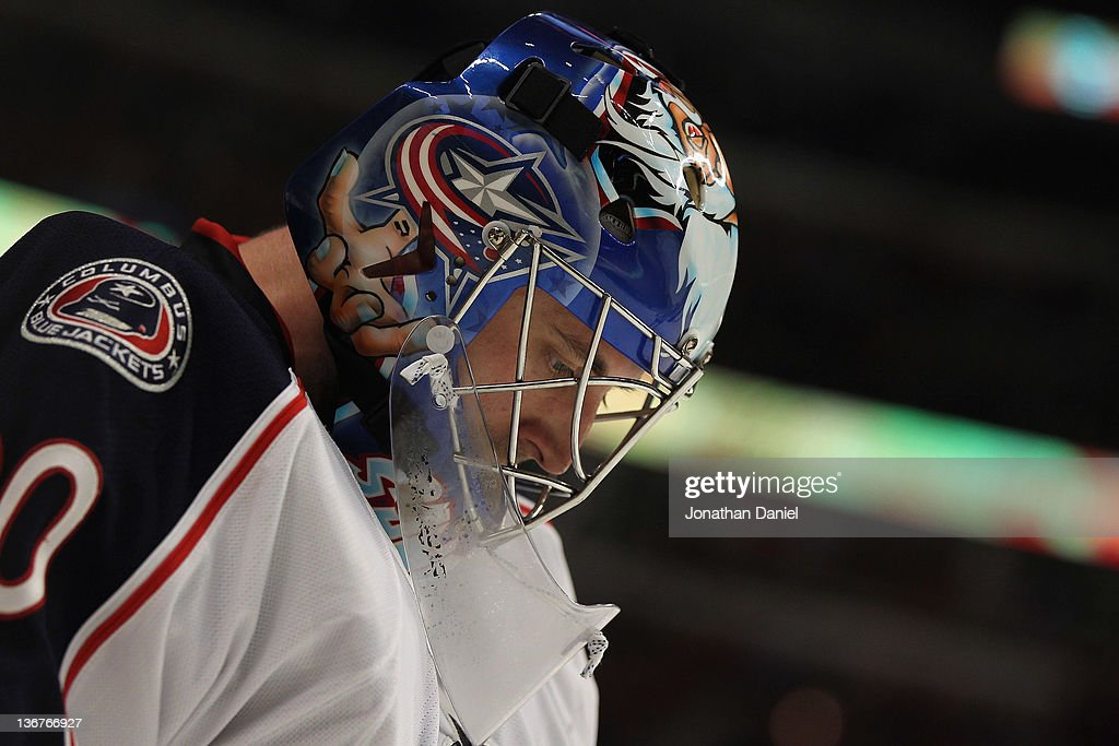 Curtis Stanford #30 of the Columbus Blue Jackets rests during a TV time-out against the Chicago Blackhawks at the United Center on January 10, 2012 in Chicago, Illinois. The Blackhawks defeated the Blue Jackets 5-2.