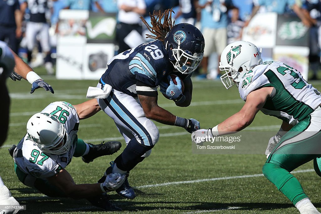 Curtis Steele #29 of the Toronto Argonauts rushes for a gain during a CFL game against the Saskatchewan Roughriders on July 5, 2014 at Rogers Centre in Toronto, Ontario, Canada.