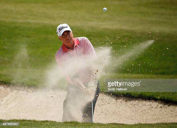 Curtis Strange hits a bunker shot on the first hole during the first round of the Insperity Invitational at the Tournament Course at the Woodlands...