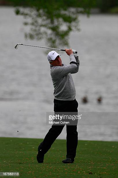 Curtis Strange hits a shot from the fairway during the first round of the Greater Gwinnett Championship held at TPC Sugarloaf on April 19 2013 in...