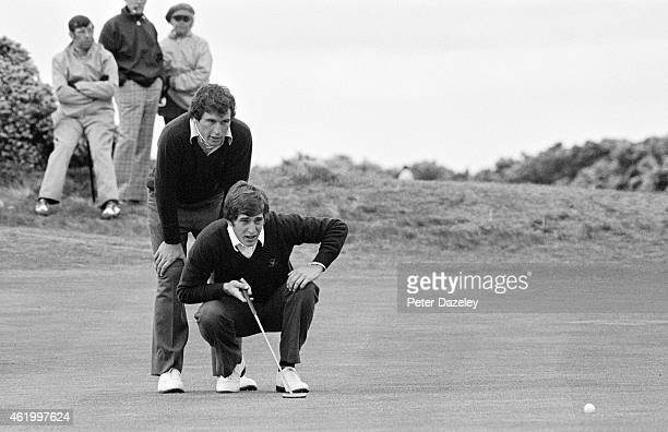Curtis Strange of the USA looks over his partner's shoulders in teh foursomes matches during the 1975 Walker Cup Match played on the Old Course on...