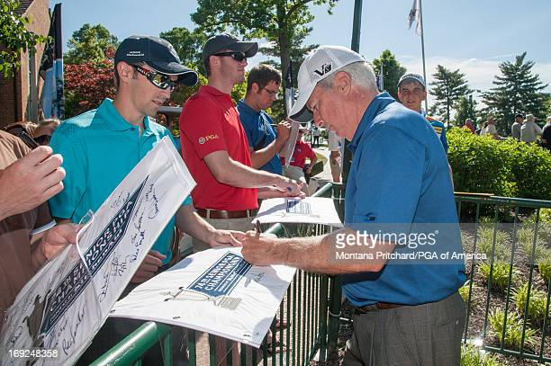 Curtis Strange signs autographs for fans during the practice round for the 74th Senior PGA Championship presented by KitchenAid at Bellerive Country...