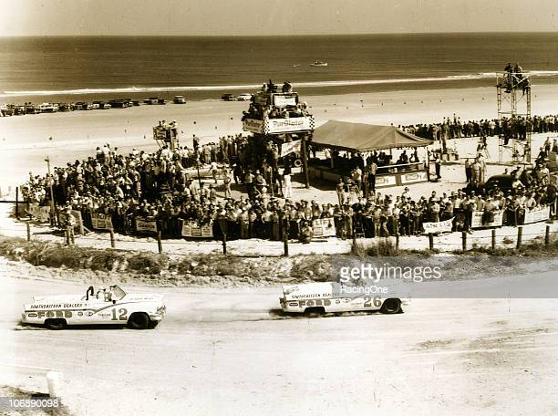 Curtis Turner and Joe Weatherly battle for the lead during the NASCAR Convertible race on the Daytona BeachRoad Course in their Pete DePaoloowned...