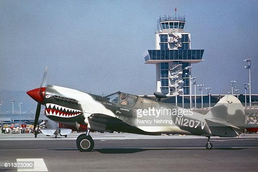 Curtiss P-40 taxiing at Oakland International Airport 1962