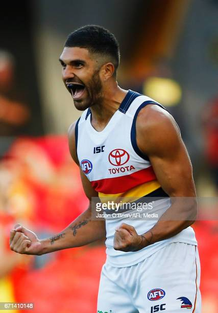 Curtly Hampton of the crows celebrates a goal during the round five AFL match between the Gold Coast Suns and the Adelaide Crows at Metricon Stadium...