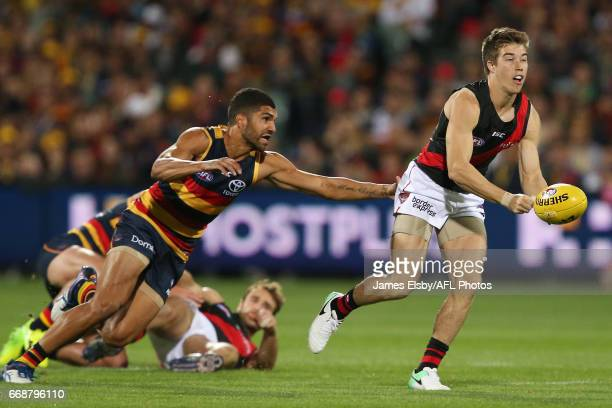 Curtly Hampton of the Crows tackles Zach Merrett of the Bombers during the 2017 AFL round 04 match between the Adelaide Crows and the Essendon...