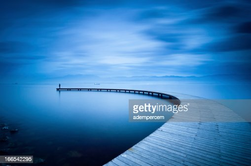 Curve of the Jetty and Man : Stock Photo