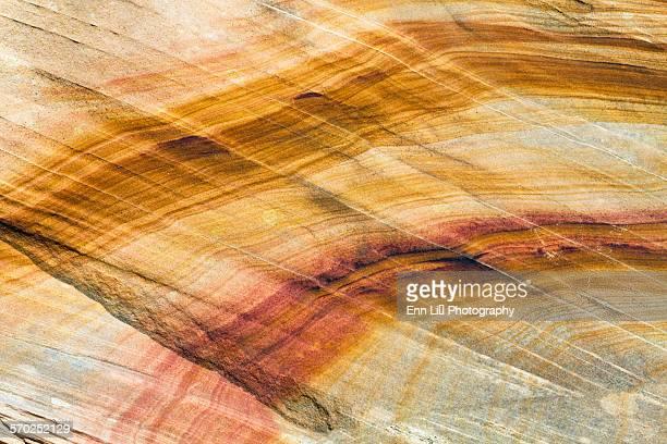 Curved lines on sandstone rock