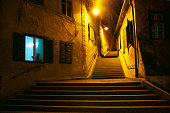 Curved narrow street at night, Sibiu, Romania