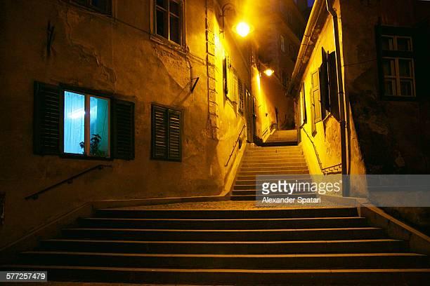 Curved narrow street at night, Sibiu, Romania