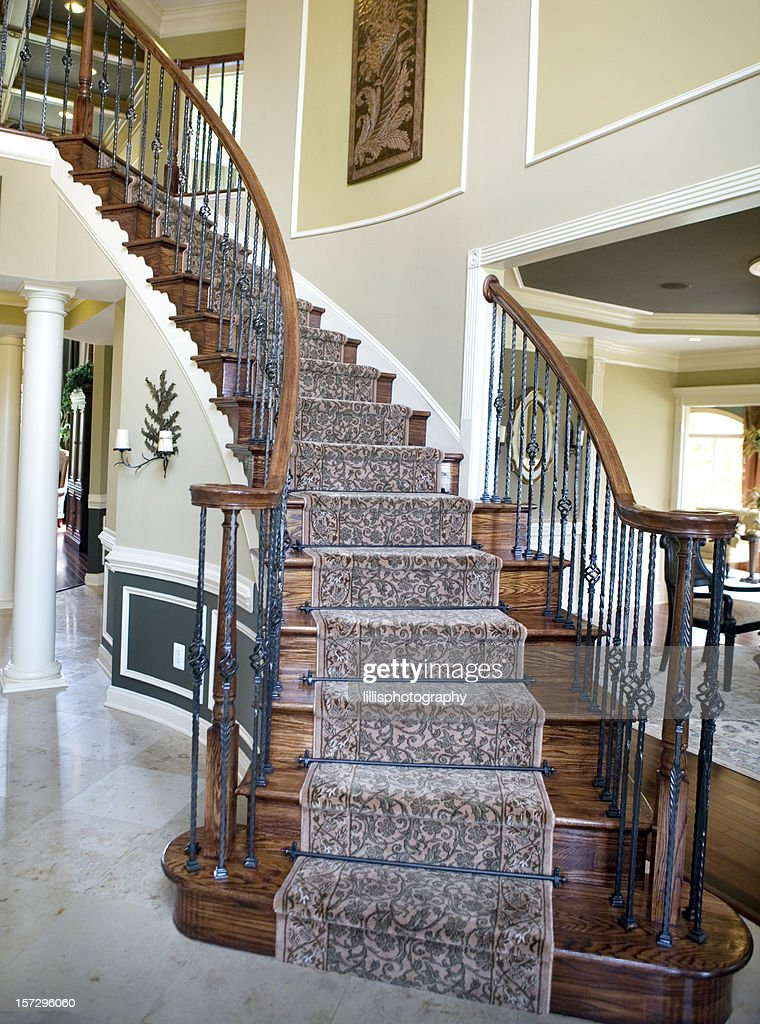 Curved staircase in modern luxury home suburbia stock for Luxury staircase