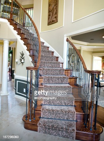 Curved staircase in modern luxury home suburbia stock for Curved staircase