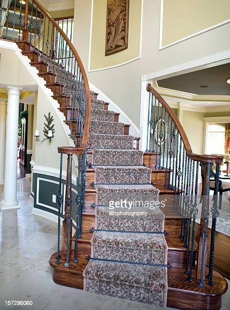 Curved Staircase in Modern Luxury Home Suburbia