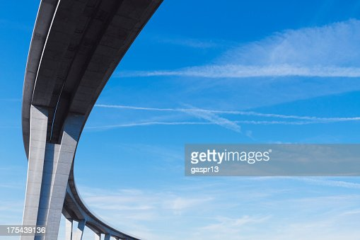 curved viaduct against blue sky