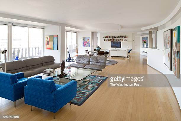 Curved wall that runs along living room dining room and TV room in Rise Birnbaum's coop at the Watergate coops in Washington DC September 17 2015