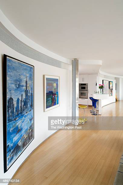 Curved wall that runs along living room dining room and TV room with the kitchen cut in the middle in Rise Birnbaum's coop at the Watergate coops in...