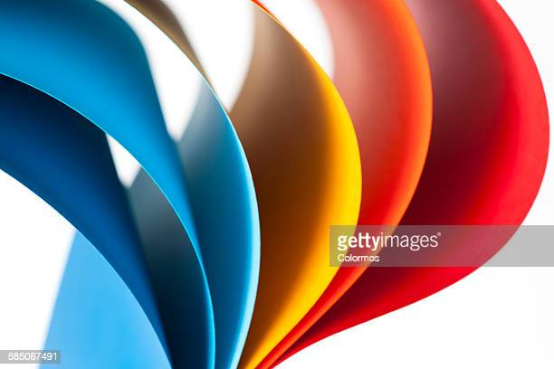 Curves of colored papers on white background