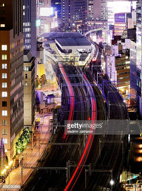 Curves of light trails from passing trains