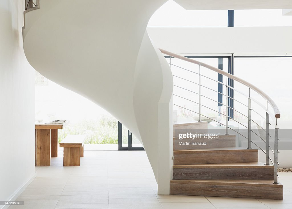 Curving staircase in modern home : Stock Photo