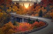 A curvy road during autumn through the mountains