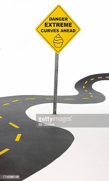 Curvy road with sign