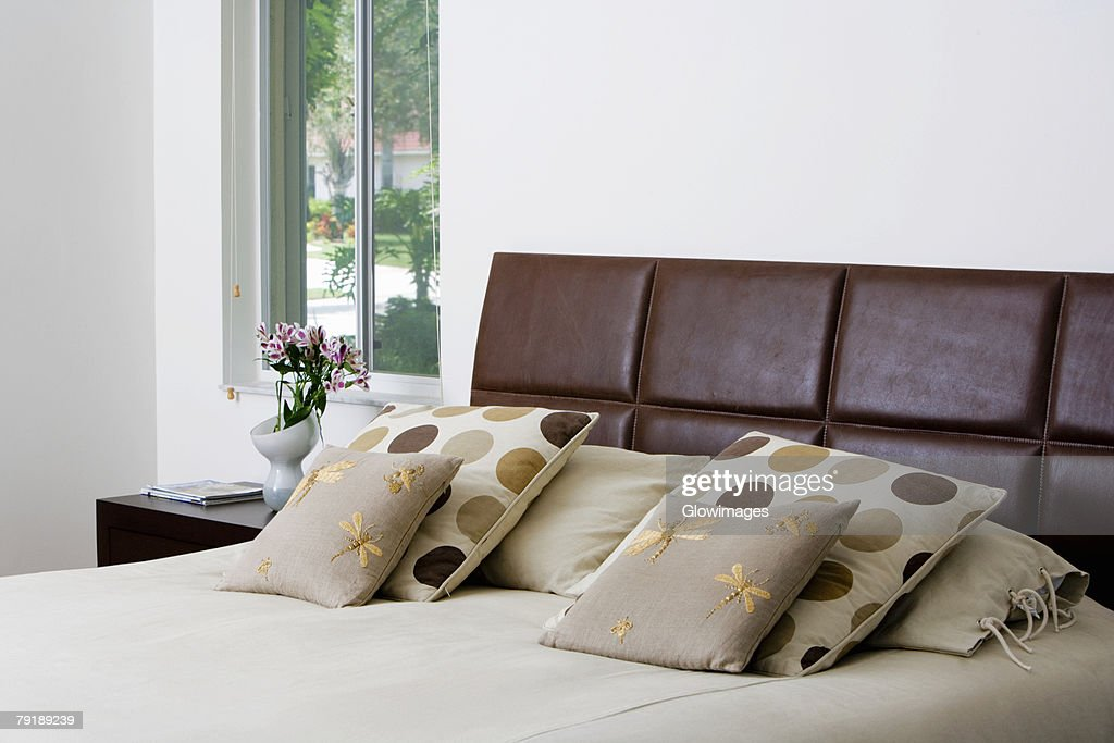 Cushions and pillows on the bed : Foto de stock
