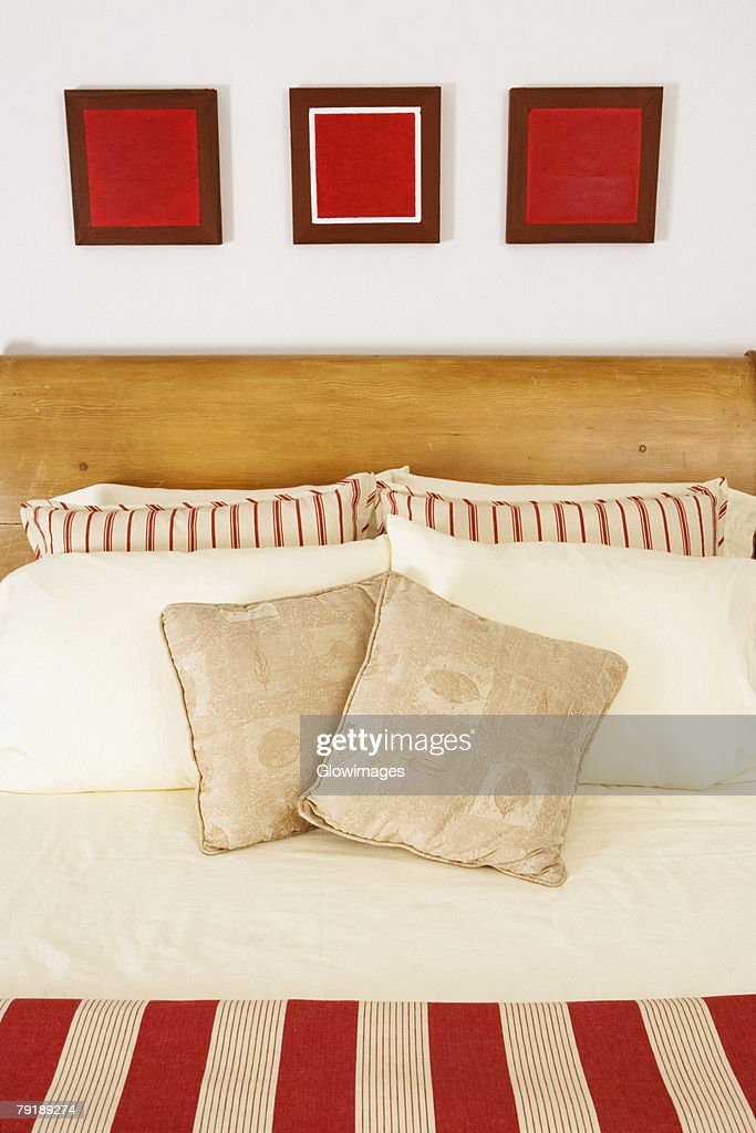 Cushions and pillows on the bed : Stock Photo