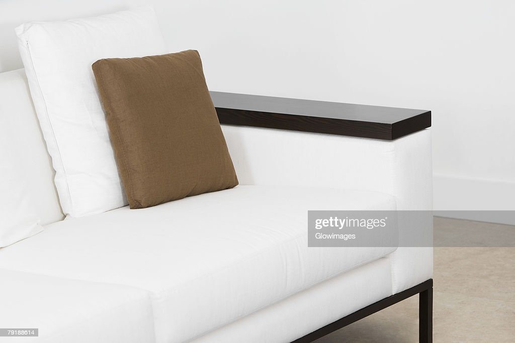 Cushions on a couch in a living room : Stock Photo