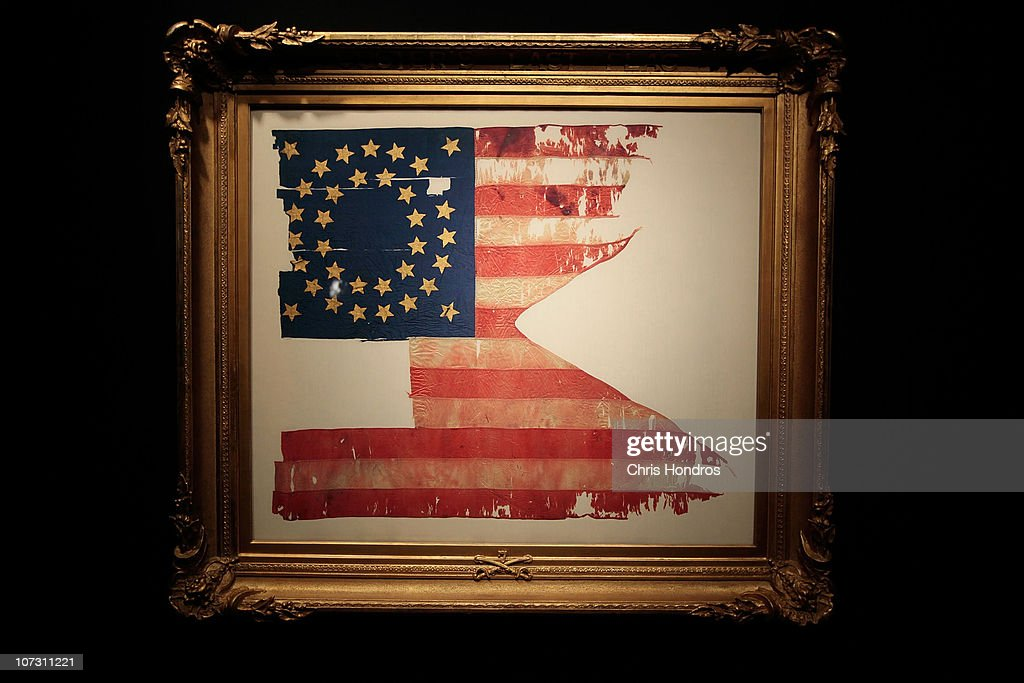 'Custer's Last Flag' is seen in a frame at Sotheby's auction house December 3, 2010 in New York City. The flag, one of the few remnants of the famous 1876 battle in which General George Custer and his men were slaughtered by a band of Native American warriors after he staged a misgiuded attack, is billed as 'the most significant and symbolic artefact recovered from the Little Bighorn battlefield' and is scheduled to be auctioned on December 10.
