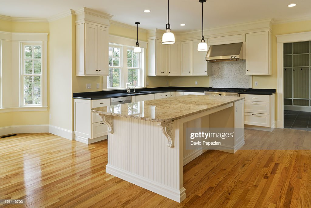 Custom built kitchen in a new house : Stock Photo