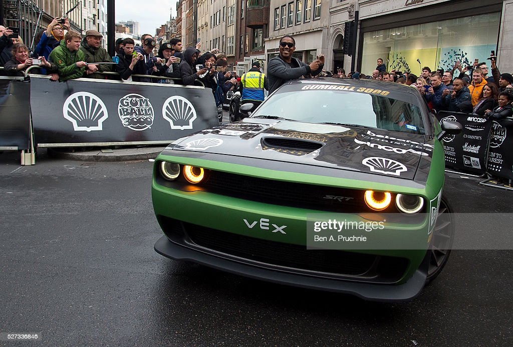 A custom car crosses the finish line as the Gumball Rally closes down Regent Street at Regent Street on May 3, 2016 in London, England.