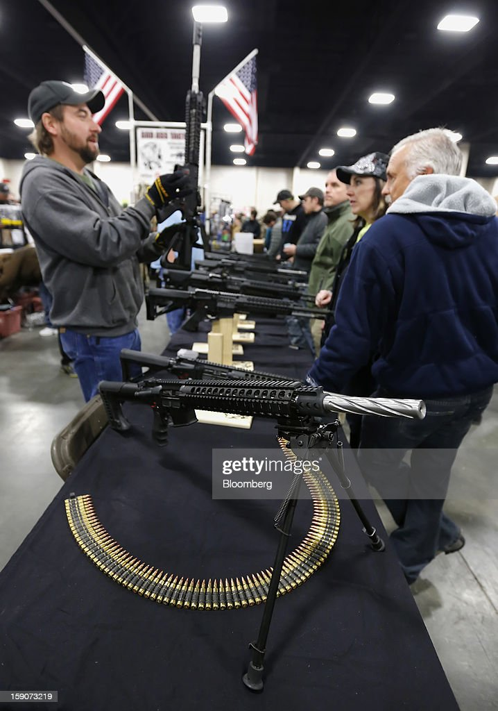 A custom made semi-automatic assault rifle sits on display at the Rocky Mountain Gun Show in Sandy, Utah, U.S., on Saturday, Jan. 5, 2013. A working group led by Vice President Joe Biden is seriously considering measures that would require universal background checks for firearm buyers, track the movement and sale of weapons through a national database, strengthen mental health checks and stiffen penalties for carrying guns near schools or giving them to minors. Photographer: George Frey/Bloomberg via Getty Images