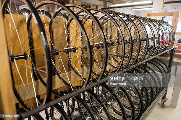 Custom made wheels sit on racks inside of the Detroit Bikes manufacturing facility in Detroit Michigan US on Thursday June 25 2015 The Institute for...